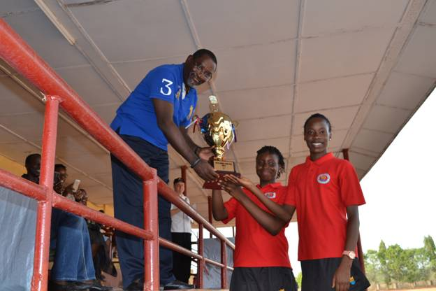 Red House Captain Adeniran Adedeji and Assistant Red House Captain Nwachukwu Chioma, receiving trophy from the Chairman Board Of Director, Prince Abimbola Olashore, on behalf of Red House, the winner of the Interhouse sports competition , at Olashore International School, Illoko-Ijesha, Osun State.