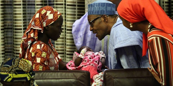 President Buhari receives rescued Chibok Girl, Amina Ali 19th May 2016. (1)