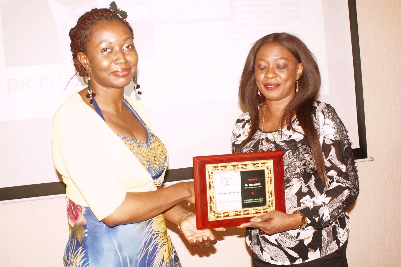 Representative of the MD of Wetherheads Advertising Group, Jennifer Onose, presenting award to the Executive Director, JSP Communications, Mrs Aderonke Adebule on behalf of Dr Phil Osagie,, recently at Nigeria Brand Awards 2016
